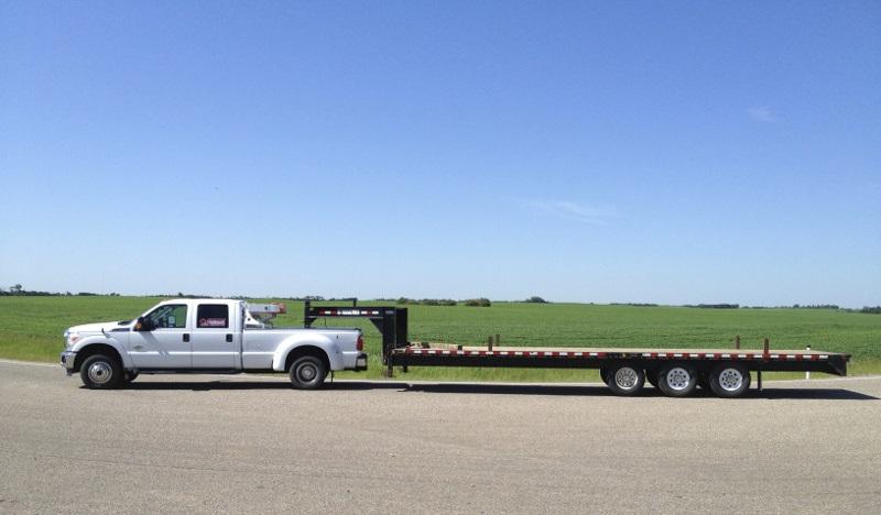 https://www.truckingfunder.com/wp-content/uploads/2021/01/1-Ton-with-30-foot-goose-neck-hotshot-truck.jpg